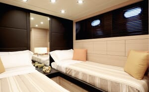 Motor yacht KAWAI twin stateroom with two single beds with low lighting