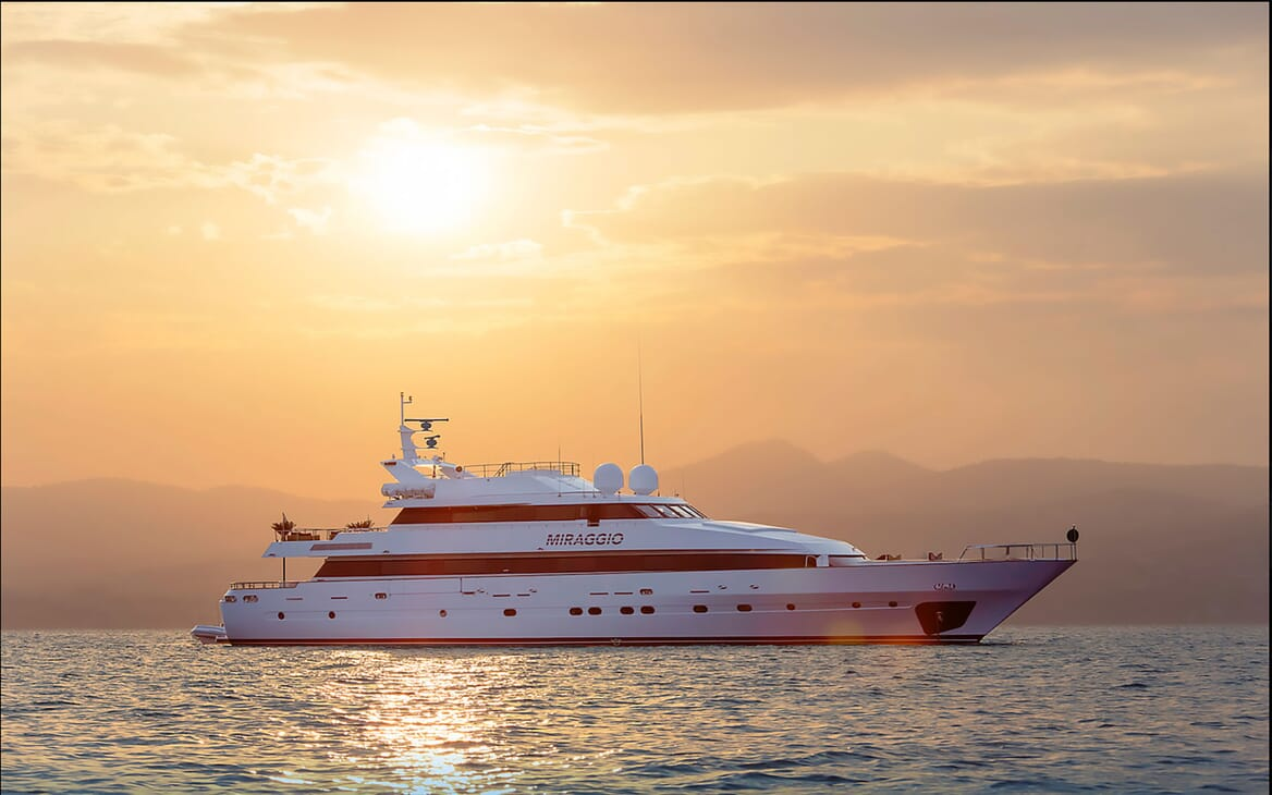 Motor yacht MIRAGGIO hero shot on water at sunset