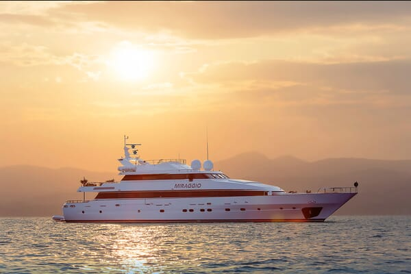 Motor yacht MIRAGGIO hero shot on water at sunset