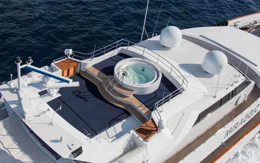 Motor yacht MIRAGGIO aerial hero shot with view of top deck jacuzzi