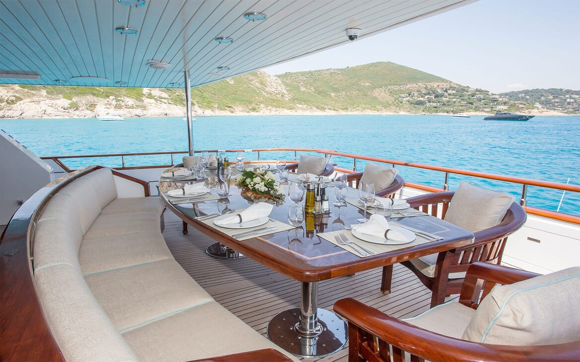 Motor yacht MIRAGGIO decking shot with dining table and seating for 10