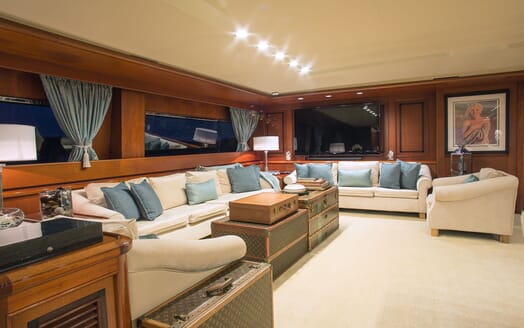 Motor yacht MIRAGGIO interior living room with cream seating and blue furnishings