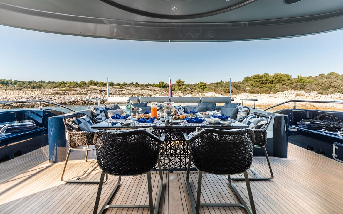 Motor Yacht ONE BLUE Main Aft Deck Dining Set Up