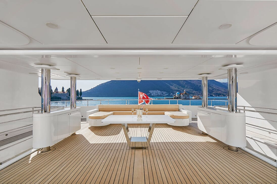 Motor Yacht DEEP STORY Aft Deck Sofa and Champagne
