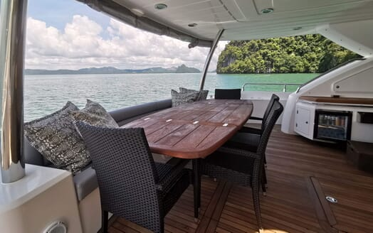 Motor Yacht MAXXX Aft Deck Dining Table