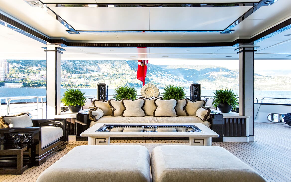 Motor yacht LIONESS V living room with deck view and mountanious landscape
