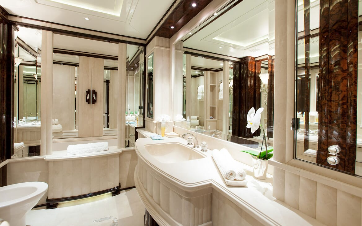 Motor yacht LIONESS V master suite bathroom with large mirrors and sink