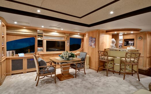 Motor yacht Quest living room and bar at night