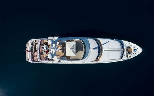 Motor yacht Quest aerial hero shot surrounded by water