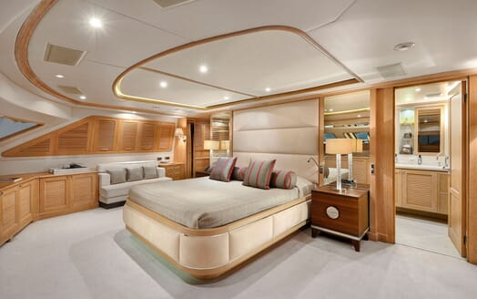 Motor yacht Quest master suite with seating area and ensuite