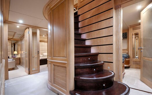 Motor yacht Quest hall way with dark wood staircase