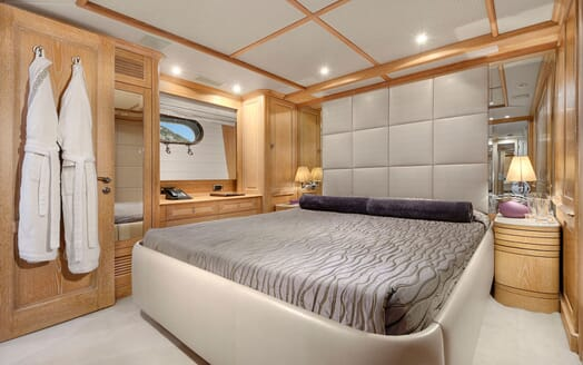 Motor yacht Quest stateroom with stone colour interiors and cream carpet
