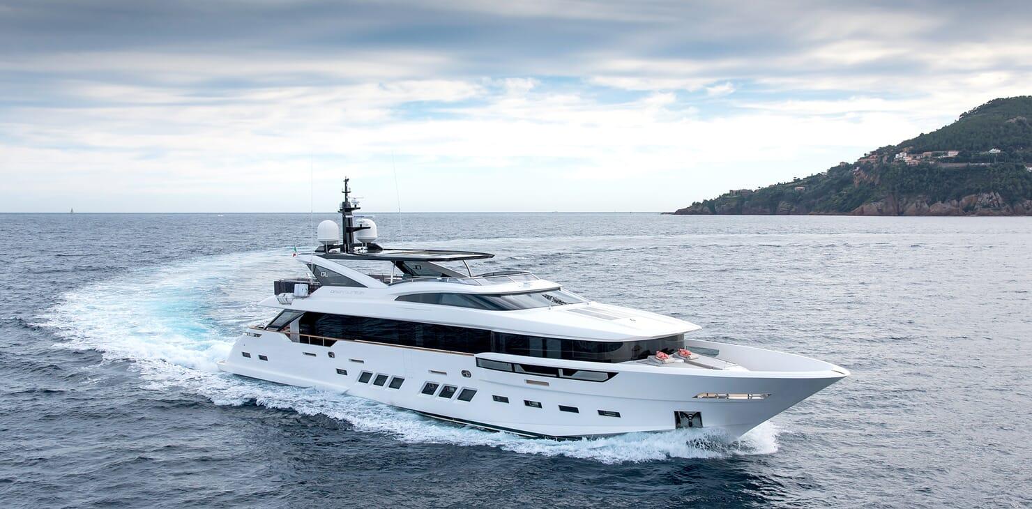 Motor yacht SOULMATE hero shot on water with cloudy skies