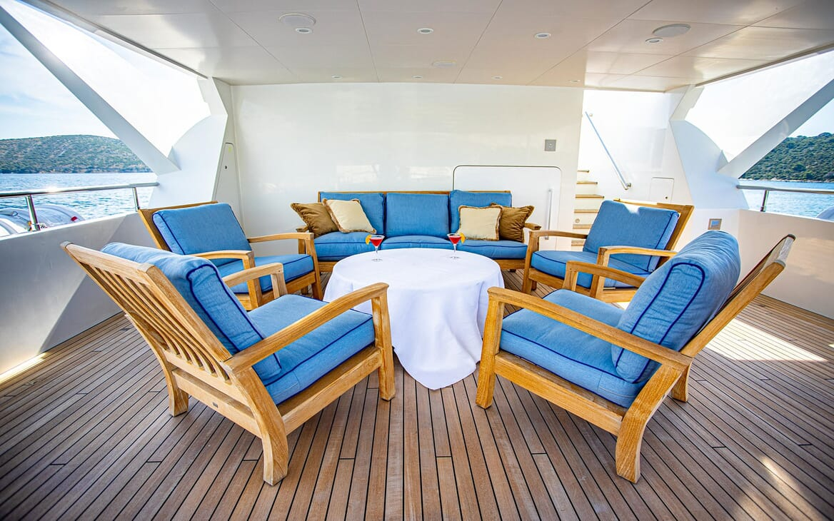 Motor yacht Milaya deck with alfresco seating area in blue