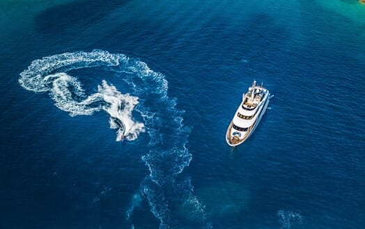 Motor yacht Milaya high aerial shot with jetski on water