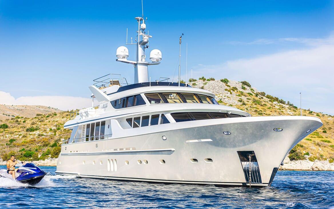 Motor yacht Milaya hero shot with jetski