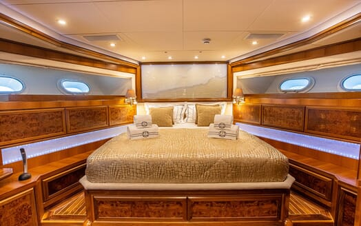 Motor yacht Milaya double bed cabin with gold and white bed linen