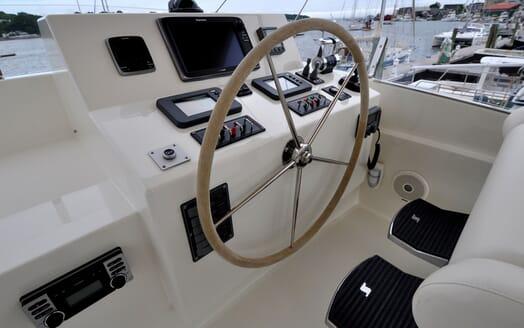 Motor Yacht Chaos helm