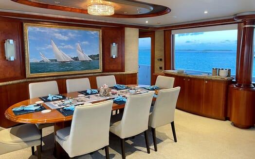 Motor Yacht RELENTLESS 130 Main Salon Dining Table