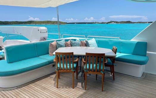 Motor Yacht RELENTLESS 130 Sun Deck Table