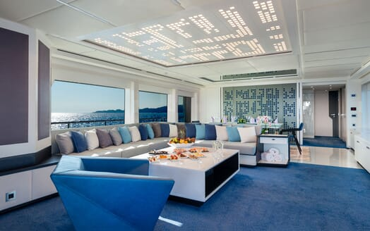 Motor Yacht SERENITAS Main Deck Salon and Dining Table