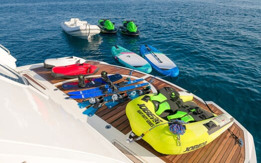 Motor yacht Quantum beach club with water toys, paddle boards and water skis