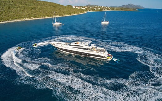 Motor yacht Quantum aerial shot with jet skis