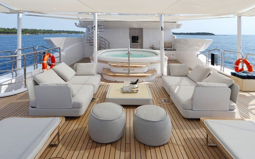 Motor yacht FORMOSA deck with vast seating and jacuzzi
