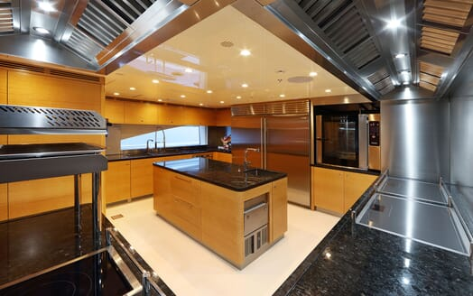 Motor yacht FORMOSA large kitchen space with island bar