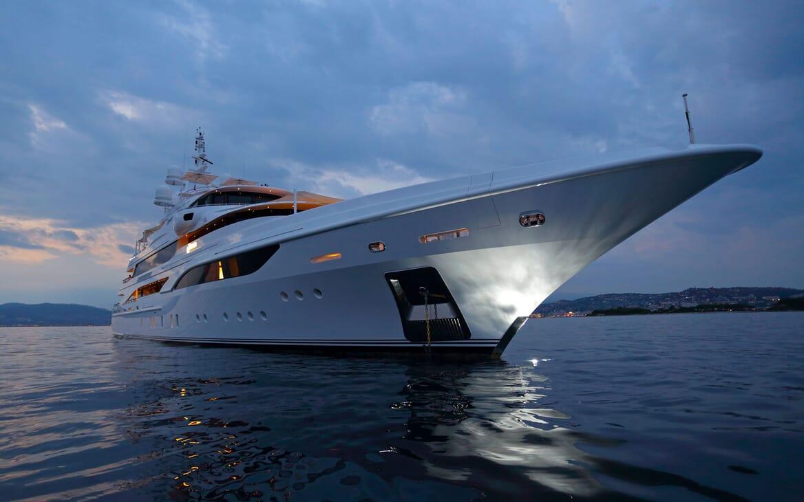 Motor yacht FORMOSA hero shot on water at dusk