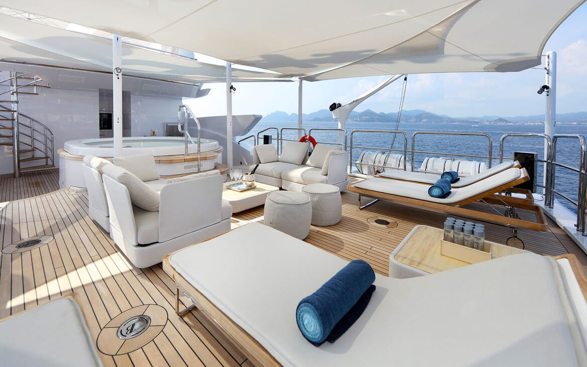Motor yacht FORMOSA deck with sunloungers and jacuzzi