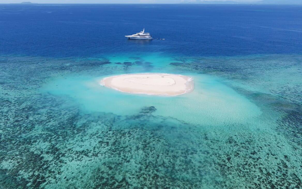 Motor yacht FORMOSA hero aerial shot on Maldives water