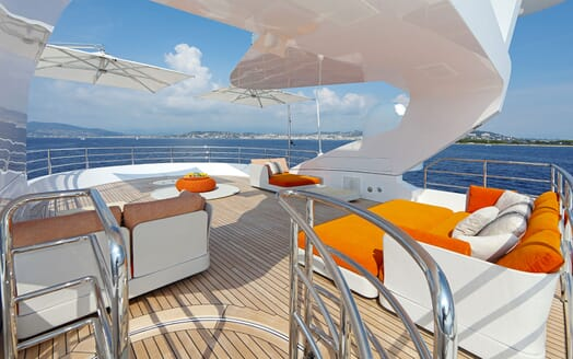 Motor yacht FORMOSA deck with orange sunpads