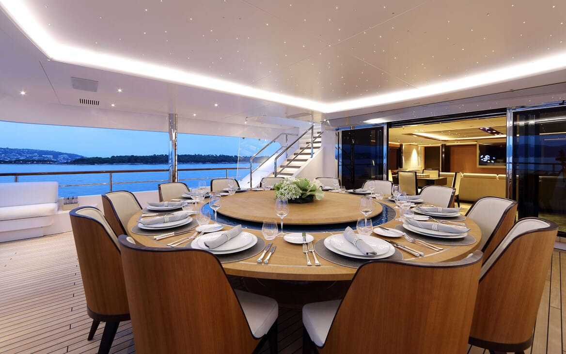 Motor yacht FORMOSA alfresco dining table with seating up to 10 guests