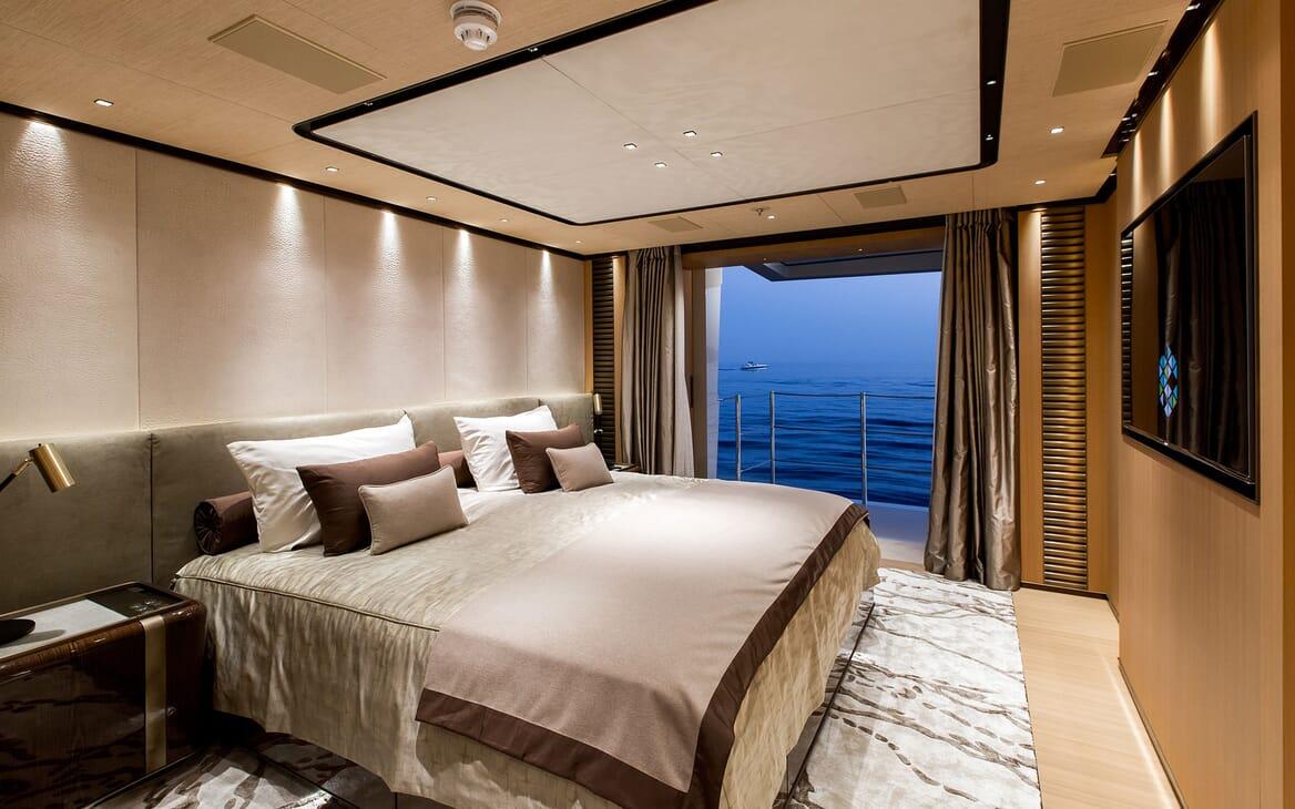 Motor Yacht VERTIGE Master Stateroom Bed and Balcony