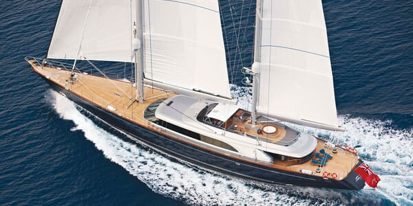 Sailing Yacht Melek aerial shot with sails up on water