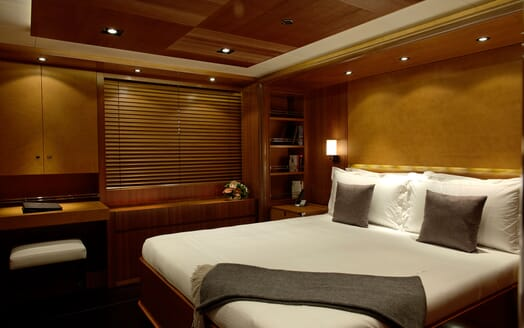 Sailing Yacht Melek interior master stateroom with wood surroundings and white bed linen