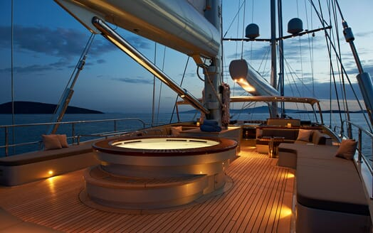 Sailing Yacht Melek deck shot with jacuzzi at night
