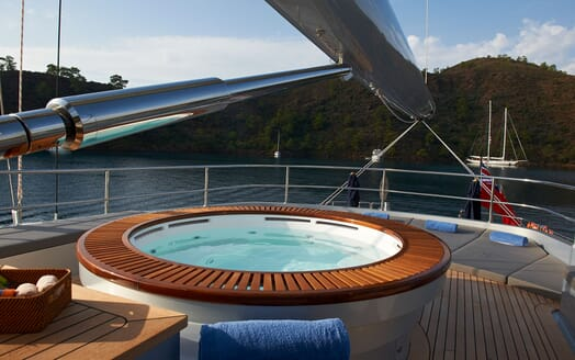 Sailing Yacht Melek deck shot with Jacuzzi and views of sailing yacht on water