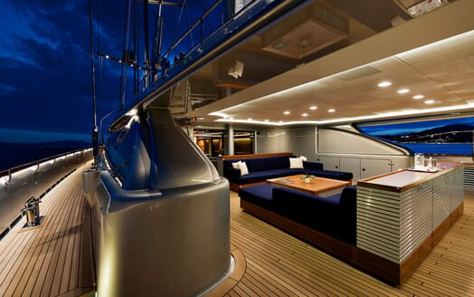 Sailing Yacht Melek deck with royal blue sofas