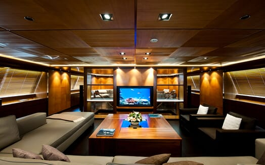 Sailing Yacht Melek living room dark interiors with low ceiling lighting