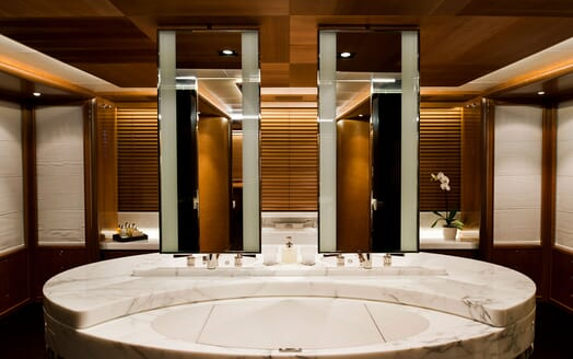 Sailing Yacht Melek bathroom with large marble bath and mirrors