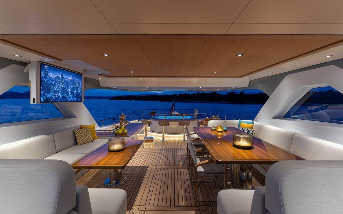 Motor Yacht MANA Sun Deck Tables and Flip Down TV