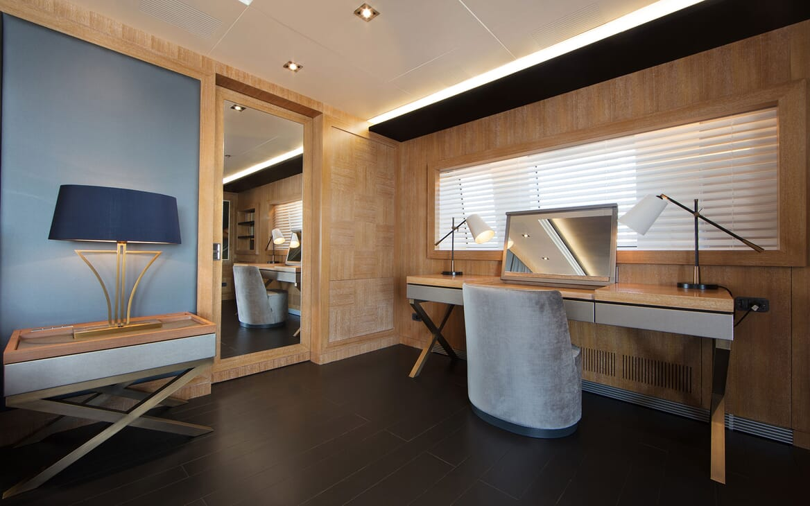 Motor yacht BEATRIX master suite with contemporary interiors, cosmetic desk and door mirror