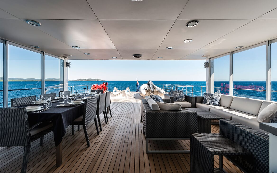 Motor Yacht OUR WAY Sun Deck Seating and Dining Table