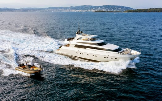 Motor Yacht PANTHOURS Underway with Tender