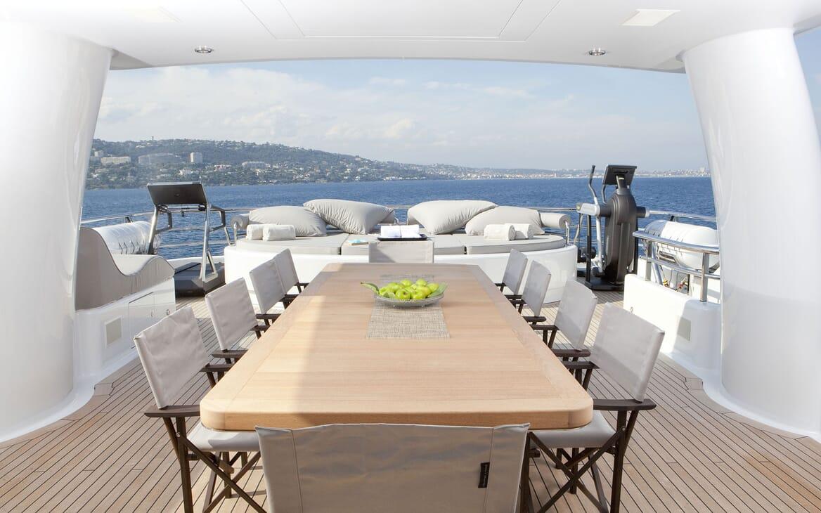 Motor yacht Spirit alfresco deck shot with lounge area, gym equipment and seaviews