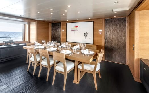 Motor yacht Spirit dining room with laid table and glassware