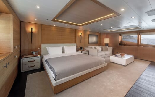 Motor yacht Spirit master suite with seating area and sea views