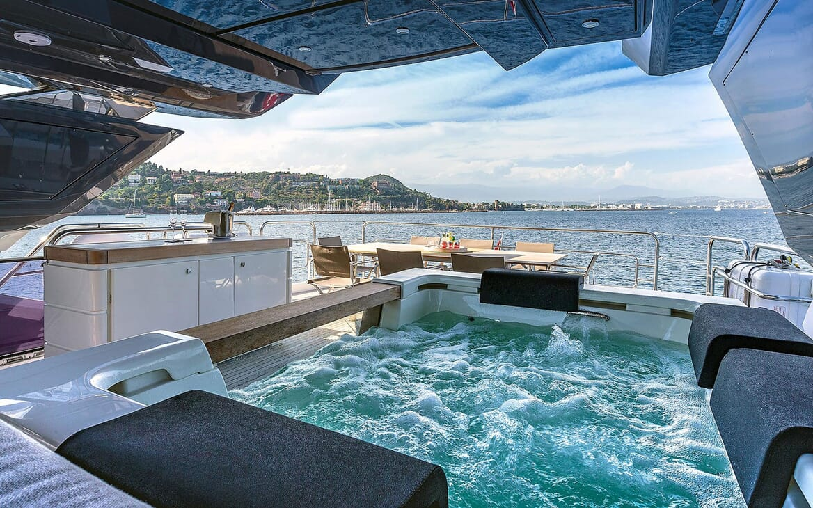 Motor Yacht EMERALDA OF THE SEAS Sun Deck Jacuzzi and Dining Table